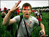 Protester with blood on his head