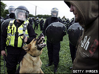 Police and dog square up to a protester