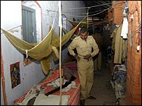 Police officers prepare to sleep in their dilapidated bunks
