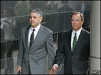 Co-defendant and former Enron chief executive Jeff Skilling, right