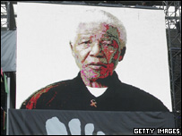 Nelson Mandela on a video screen