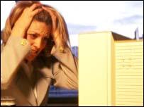 Woman holding head in hands, Eyewire