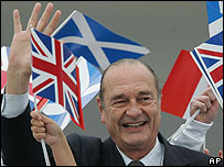 Jacques Chirac puts a brave face on defeat as he arrives at the G8 summit in Scotland