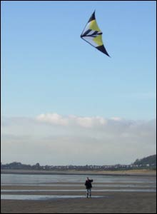 Dafydd Jones' girlfriend Corinne Squire flying a kite on Ogmore-on-Sea beach