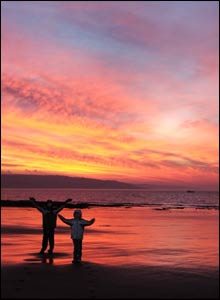 Jonathon and Hannah Berry at sunrise, Newton Beach, taken by Lee Canning of Cardiff