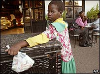 Child with Zimbabwean dollars in a bag