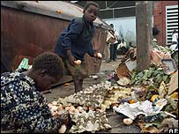 Children in Harare play in uncollected rubbish