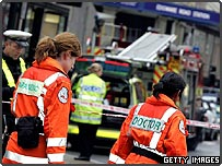 Paramedics attend one of the bomb sites