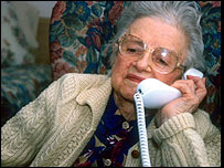 An elderly woman on the phone