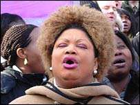 A woman sings during the protest against the religious hate laws