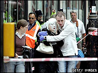 A man helping an injured woman in central London