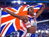 Denise Lewis waving the Union Jack