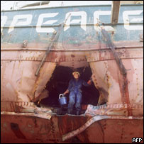 A worker looks at the hole in the ship, August 1985