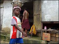 Boy hawker in Nigeria
