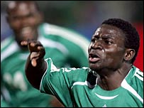 Obafemi Martins celebrates after scoring his first goal against Senegal