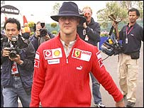 Michael Schumacher arrives at Silverstone ahead of the British Grand Prix