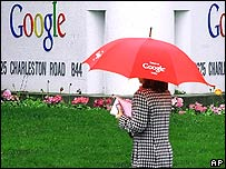Woman walking past Google's headquarters