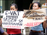 Women protest against the higher VAT and oil price increases in Manila