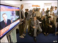 Journalists at Gleneagles watch TV coverage of the day's events