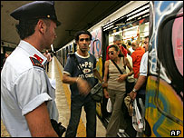 An Italian police officer patrols the Colosseum subway station in central Rome