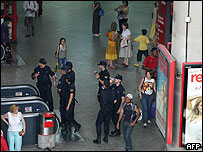 Police patrol in Atocha station in Madrid