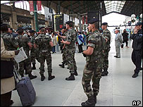 Soldiers patrol the Gare du Nord train station in Paris