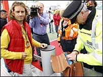 Jartno Trulli is searched as he enters Silverstone