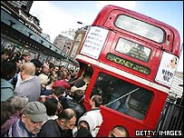 People getting on London commuter bus