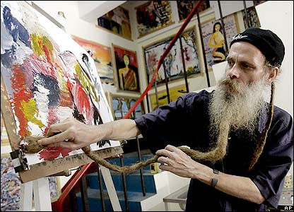 Artist Marco Figgen paints using his beard