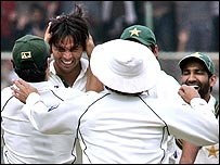 Mohammad Asif celebrates with his team-mates after taking Sachin Tendulkar's wicket