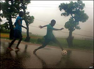 Boys play football in Les Cayes, Haiti