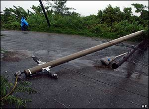 Electrical poles are knocked down by gusting winds in Port Morant, Jamaica
