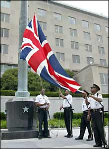Police officers raise a union jack in front of the State Department in Washington DC, in remembrance of those killed in the London bombings.