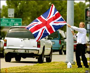 Robert Santurri, of Madison, Wisconsin, waves the union jack as traffic passes