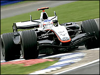 Kimi Raikkonen puts the McLaren through its paces at Silverstone