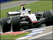 Kimi Raikkonen puts the McLaren through its paces at Silverstone
