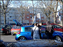 French youths by a car in the suburbs