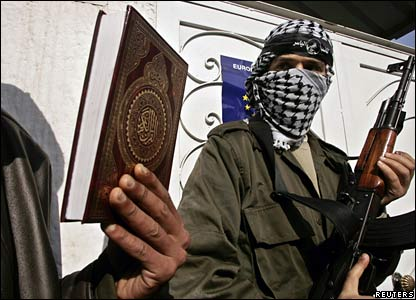 A Palestinian gunman holds the Koran in a protest outside the EU mission in Gaza