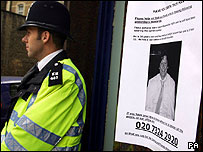 Police with a missing persons poster near Tavistock Square