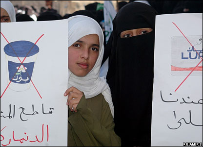 Two Yemeni women hold placards calling for a boycott of Danish goods