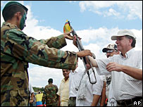 Paramilitaries hand over weapons in Colombia