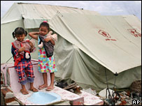 Two girls outside their tent home in Banda Aceh