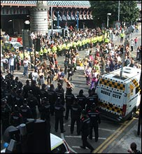 The police surround protesters to contain them on the bridge. Picture by Yvonne Cairns.