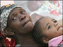 A girl orphaned by Aids with her grandmother in South Africa