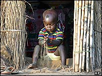 A boy plays with sand on the outskirts of Abuja, Nigeria