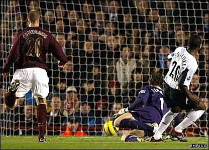 Nigel Reo-Coker slides the ball under Jens Lehmann to give the away side the lead at Highbury