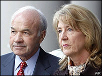 Ken Lay, former Enron chairman, arrives at court with his wife Linda