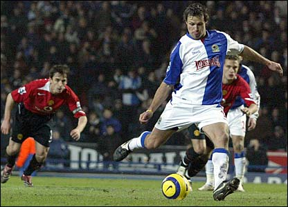 Lucas Neill strokes home a first-half penalty