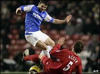 Birmingham's Damien Johnson and Liverpool's Daniel Agger