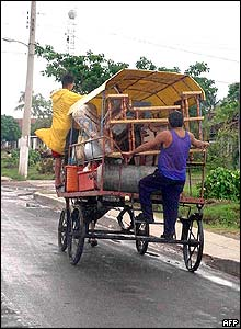 Cubans use a cart to move their belongings